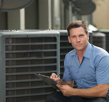 Air Conditioning Repairman With Clipboard
